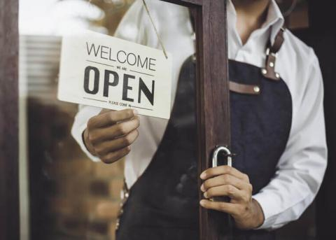 Business owner open sign